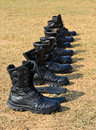 Military boots a row of Royalty Free Stock Photo