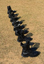 Military boots row of on field Royalty Free Stock Photography