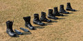 Military boots row of on field Stock Images