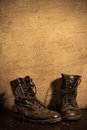 Military boots still life photography with Royalty Free Stock Photo