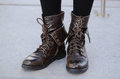Military chic style women's boots Royalty Free Stock Photo