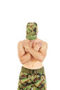 Military combatant officer praying with arms crossed and head bo bowed peaceful Stock Image