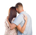 Military couple from behind hugging looking away on white affectionate isolated Royalty Free Stock Photography