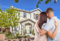 Military couple looking at nice new house affectionate Stock Photography