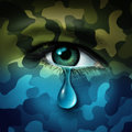 Military depression mental health concept and casualty of war symbol as a crying human eye tear with green camouflage transforming Royalty Free Stock Image