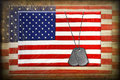 Military dog tags on flag Stock Image