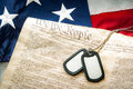 Military dog tags, the US Constitution and the American flag Royalty Free Stock Photo