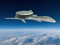 Military drone strike electronic warfare flying above the clouds through a blue sky war has changed with new weapon technology Stock Photos