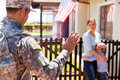 Military father waving goodbye to his sad family Royalty Free Stock Photography