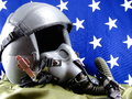 Military fighter pilot helmet and American Flag Royalty Free Stock Photos