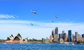Military helicopters fly over sydney australia october four and by the opera house ib a beautiful spring day Stock Photo