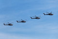 Military helicopters a group of flying on the background of blue sky Royalty Free Stock Photography