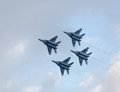 Military jet planes showing aerobatics four war in sky russian Royalty Free Stock Photos