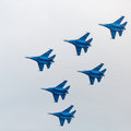 Military jet planes showing aerobatics six war in sky russian Stock Photography