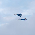 Military jet planes showing aerobatics two war in sky russian Royalty Free Stock Image