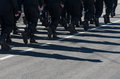 Military marching formation.Shadows on the road.