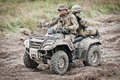 Military off road special forces soldiers on all terrain vehicle fast response squad Royalty Free Stock Photography