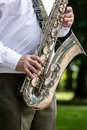 Military orchestra musician playing saxophone on music festival Royalty Free Stock Photo