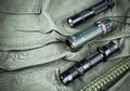 Military paracord bracelet, tactical torch and spy-glass Royalty Free Stock Photo