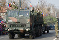 Military parade army trucks with soldiers saluting on a celebrating the romania s national day december in bucharest romania Stock Images