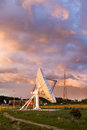 Military radar station at sunset parabolic antenna on a surveillance compound Royalty Free Stock Photos
