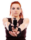 Military redhead beautiful young lady woman with gun holster and outfit isolated on white background Stock Photo