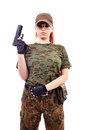 Military redhead beautiful young lady woman with gun and outfit isolated on white background Royalty Free Stock Photography
