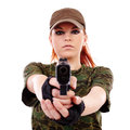 Military redhead beautiful young lady woman with gun and outfit isolated on white background Stock Photography