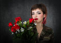 Military and roses Royalty Free Stock Photo