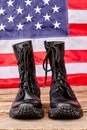 Military soldier boots against american flag background. Royalty Free Stock Photo