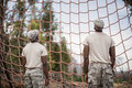 Military soldiers looking at net during obstacle course Royalty Free Stock Photo