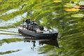 Military speedboat a miniature on a pond Royalty Free Stock Image