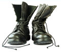 Military style black leather boots on white background Stock Images