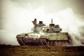 Military tank on war heavy in the field of battle mission in dust and smoke Royalty Free Stock Photography