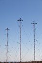 Military telecommunication towers over a blue sky Royalty Free Stock Images