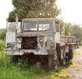 Military truck a is neglected in field Stock Photo