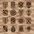 Military unit patch insignia set on tan camouflage Royalty Free Stock Photo