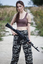 A military woman with an automatic rifle ak-74 Royalty Free Stock Images