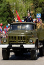 Military zil with the actors in the form of the great patriotic war carrying parade marking anniversary victory world Stock Image