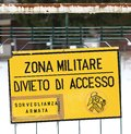 Military zone sign off from a military base in italy attention Royalty Free Stock Photo