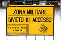 Military zone sign off from a military italian base attention in europe Royalty Free Stock Photo