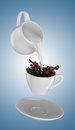Milk being poured into small cup of coffee. 3d