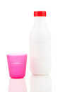 Milk bottle and plastic beaker isolated on white background Stock Images