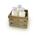 Milk in bottles in wooden box on white background Royalty Free Stock Photo