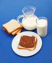Milk and bread with chocolate Stock Images