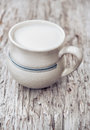 Milk in ceramic mug on the old wood background Royalty Free Stock Image