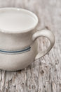 Milk in ceramic mug on the old wood background Royalty Free Stock Photography