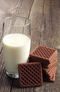 Milk and chocolate cookies glass of on vintage wooden table Royalty Free Stock Images