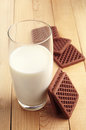 Milk and chocolate cookies glass of on wooden table Stock Photo