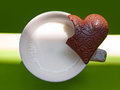 Milk and chocolate cup of incomplete heart shaped Royalty Free Stock Photography